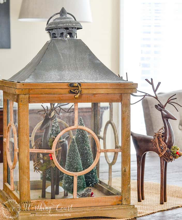 Decorating With Lanterns   Worthing Court How To Decorate With Lanterns   Fill a lantern with mini Christmas trees  and small deer