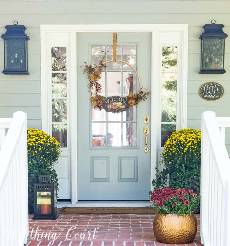 Front porch decorated for fall Fall front porch #FallDecor #Mums #FallPlanters #PorchDecor