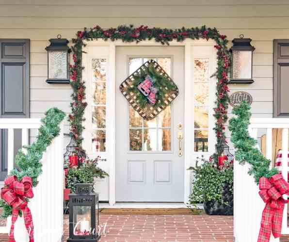 Festive Christmas front porch decorated with red and green #christmas #christmasdecor