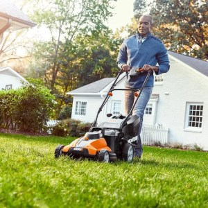 man mowing lawn with battery powered lawn mower from Worx