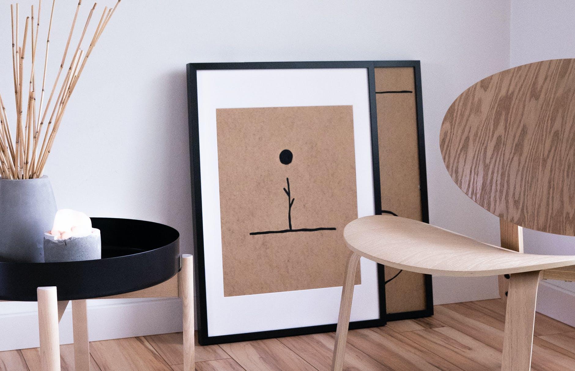 frames on brown wooden floor