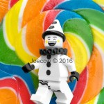 Happy clown in front of lollipop