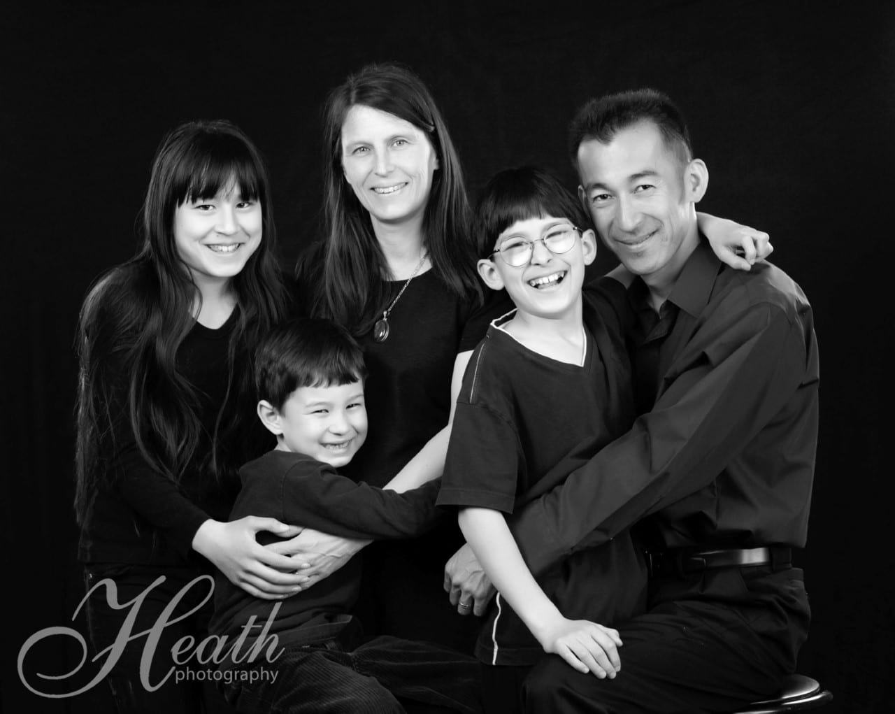FAMILY SESSION PACKAGE <br/> Donated by: HEATH PHOTOGRAPHY <br/> Valued at: $390