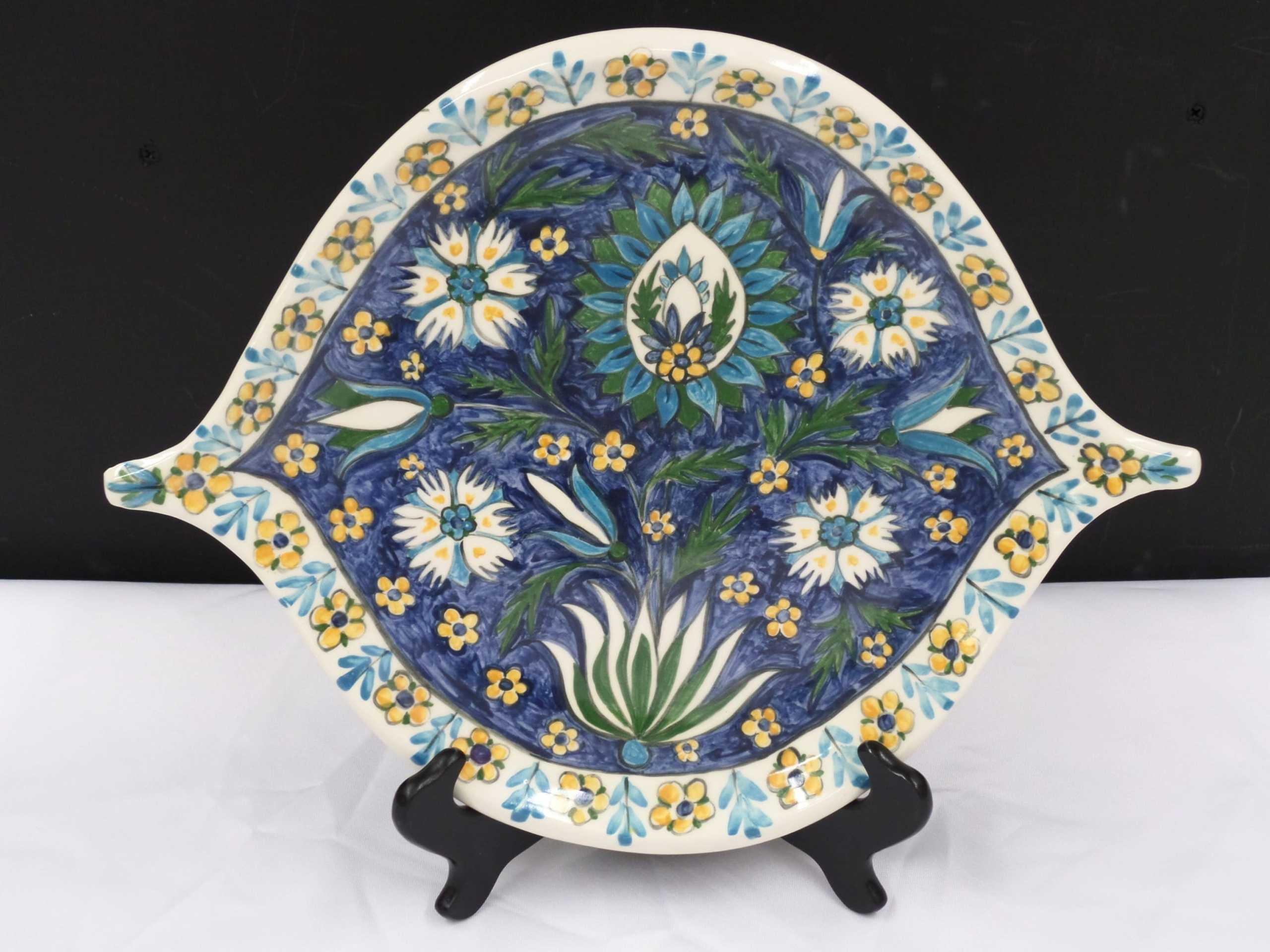 """11"""" FLORAL CERAMIC PLATE <br/> Donated by: ARTIST URSULA MICKLE <br/> Valued at: $80"""