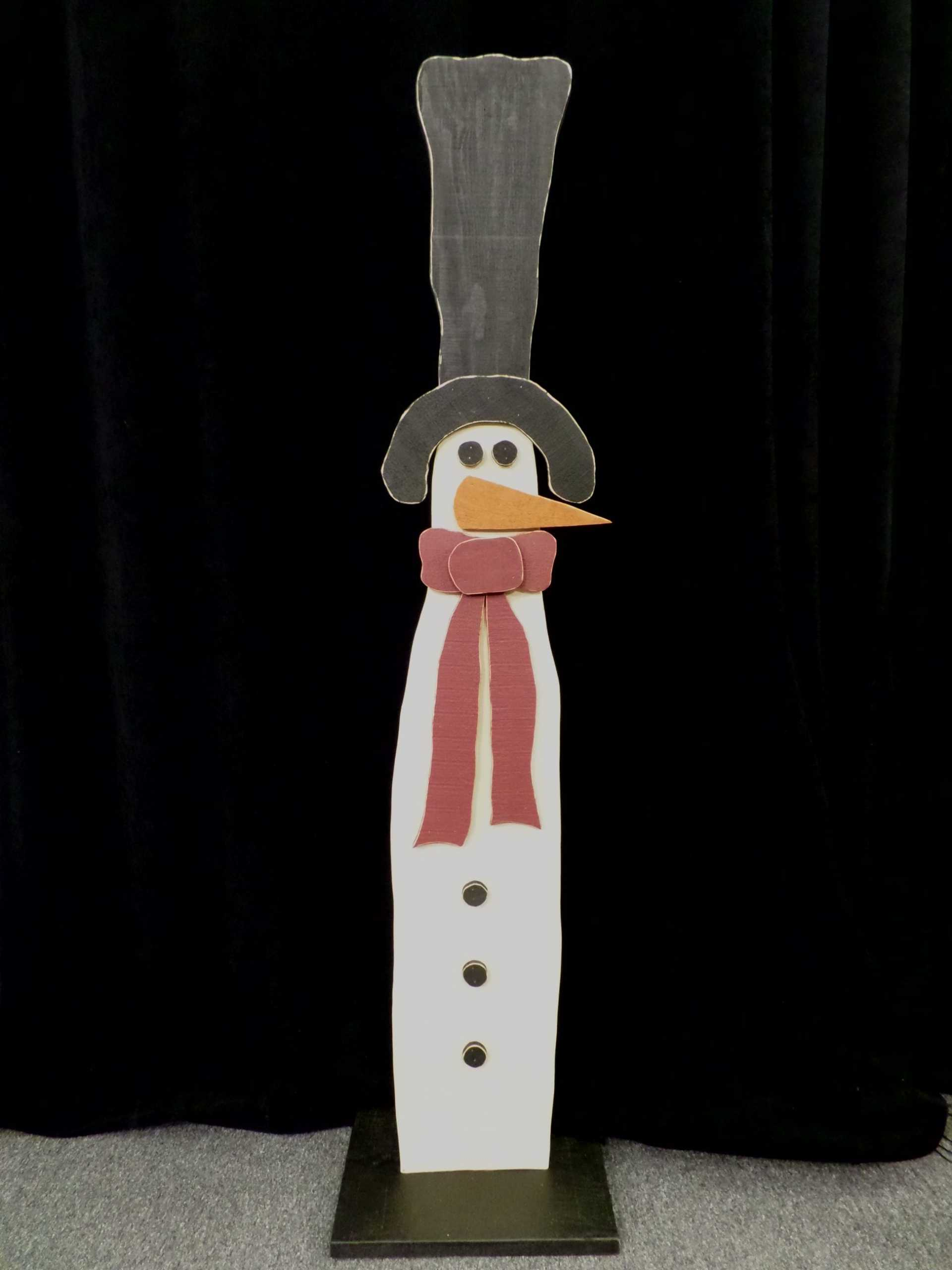 LARGE WOODEN SNOWMAN <br/> Donated by: CEDAR MOUNTAIN MERCANTILE <br/> Valued at: $70