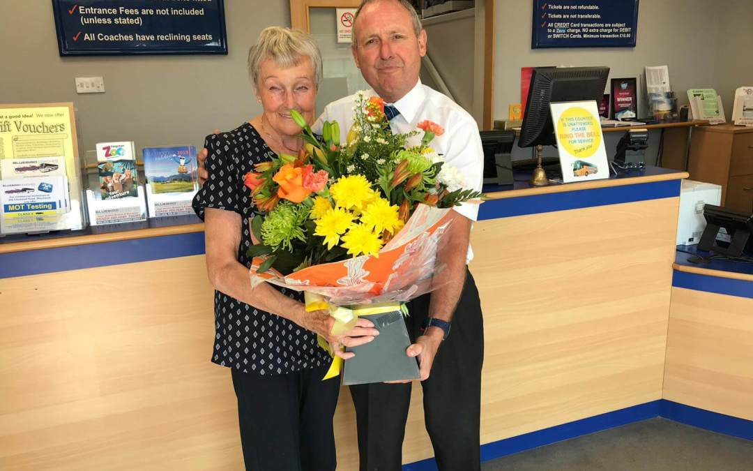 MAUREEN SCHOFIELD CELEBRATES HER 80TH BIRTHDAY AT WORK WITH BLUEBIRD COACHES WEYMOUTH
