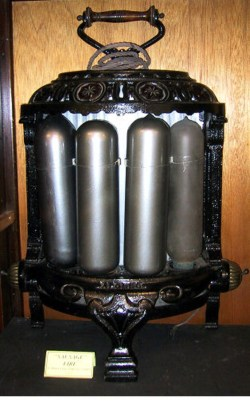 SWEHS000019.jpg - Date c1910 - Apollo Dowsing Sausage The electric filament lamp was considered inefficient because far more energy was converted into heat than produced light. H J Dowsing designed a heating lamp in 1896 with a frosted glass envelope. It had a 250w carbon filament which gave off no light except a warm red glow. These were the first practical heaters..