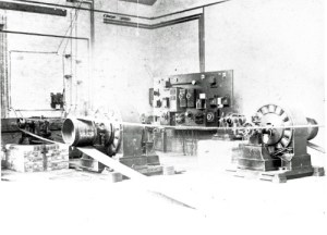 SWEHS 17.0.013.jpg - Date 1892 - First 3kW alternators at St James Street generating station. BTH flat wound rotor, 2.2kV 30amp. Compound wound alternators 133 Hz, 1140rpm. Somerset, Taunton Note unguarded belts and slight changes in control gear to that shown in 17.0.011..