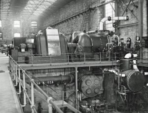 SWEHS 7.1.132.jpg - Date 1928 - Interior of Hayle power station 20th June 1928 with BTH 7.5MW turbo alternator, 25cycle. Two Babcock & Wilcox boilers 50,000 lbs/hour, BTH 10kV switchboard. This plant was the first to operate at 250 lbs/ sq. in. Cornwall, Hayle It was orginally coupled to the old 180 lb/sq.in. plant through pressure reducing equipment. Reverse of photo shows names of some of those looking toward camera..