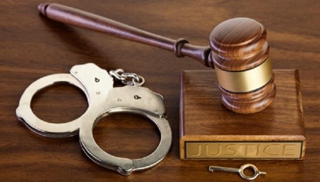 Court generic with handcuffs_1545854334675.jpg.jpg