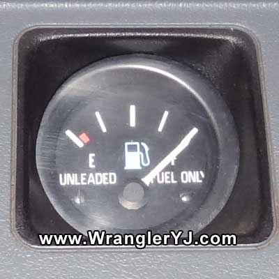 FULL tank with the engine stopped.