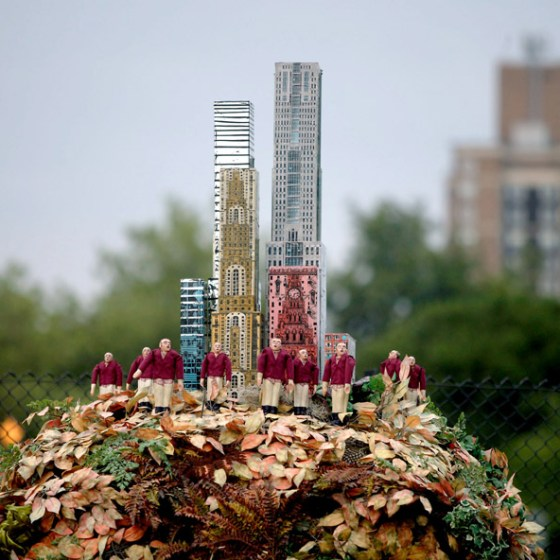 A model city rises out of the top of the compost heap