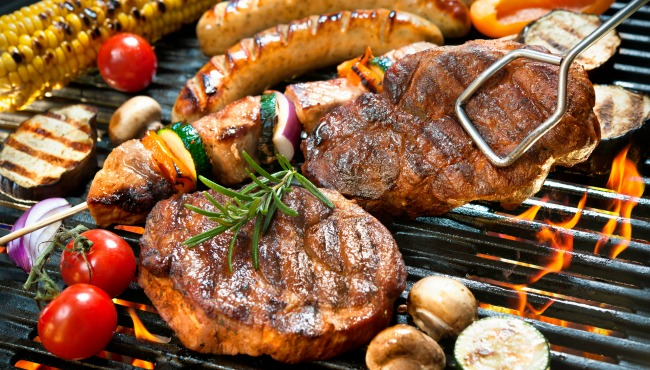 Assorted delicious grilled meat with vegetable over the coals on a barbecue_169443