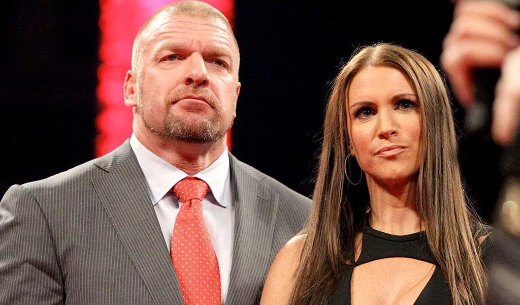 Triple H, Stephanie McMahon, and Michael Cole congratulate Renee Young on new appointment