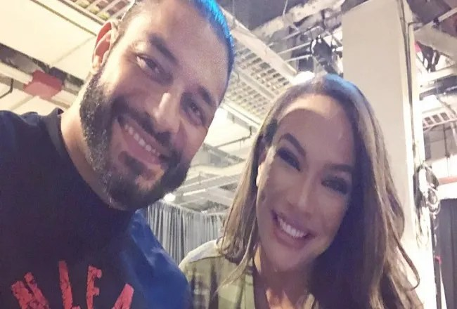 Nia jax hugs Roman Reigns