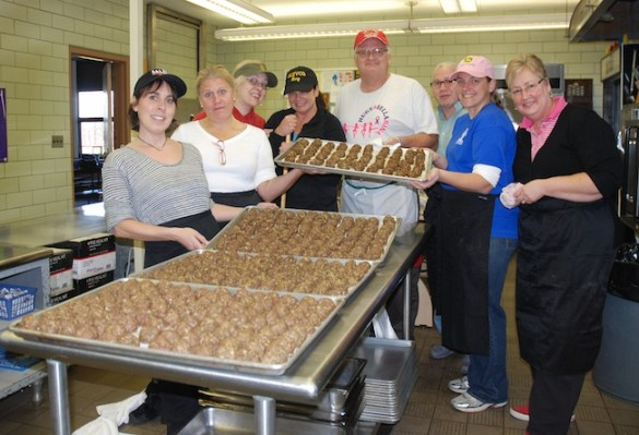 Bush Elementary School staff members, Joanne Galbier, Teri Geisler, Terry Smith, Mary Neumann-Ceminilli, Principal Dan Bracey, Fred Cordero, Amanda Sischo and Bonnie Walsh, prepare meatballs for the school's Pasta Dinner.