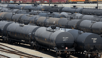 Crude oil rail cars, like the ones shown here, are becoming more prevalent on the nation's rail lines. As a result, New York State is calling on the federal government to improve safety regulations regarding the transportation of crude oil via rail.