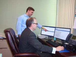 City Development Director Vince DeJoy (seated) with an unidentified staff member.