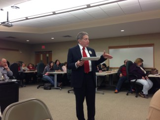 Jamestown School Superintendent Tim Mains discusses the 2015-16 budget numbers with the school board during the March 12 meeting.