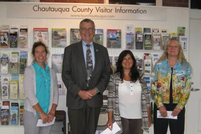 Pictured from left to right: Shelly Wells, contest winner; Vince Horrigan, Chautauqua County Executive; Tracie DeMotte, contest winner; and Chris White of the International Order of The King's Daughters and Sons. Not pictured is contest winner Guy Karam.