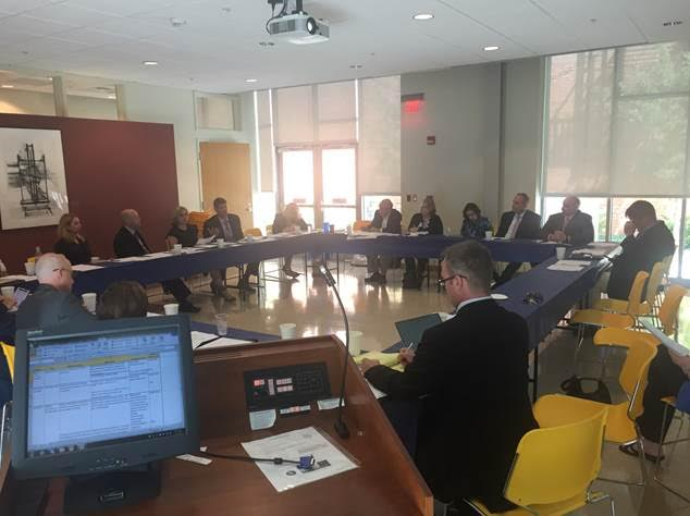 Above, community members of the Chautauqua County Education Coalition gather to understand job descriptions and the workforce development needs of Athenex.