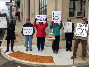 Residents Gather in Downtown Rally to Voice Opposition to GOP Tax Plan