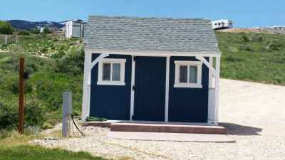 blue shed with porch