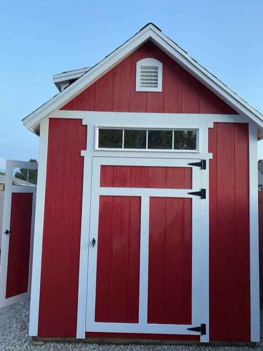 white door trim on red shed