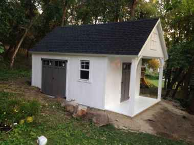 white orchard shed with gable porch