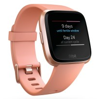 Product render of Fitbit Versa in 3 quarter view in classic peach and rose gold showing female health screen