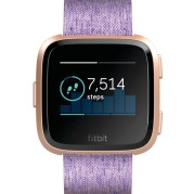 Product render of Fitbit Versa in front view with special edition lavender woven band and rose gold aluminum body showing home 7day steps on screen