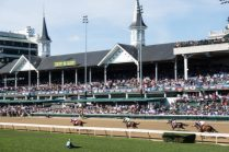 Churchill Downs with horses racing fast fast fast