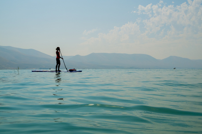 Woman paddleboarding on Bear Lake.