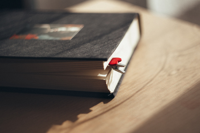 A book with a heart-shaped bookmark.