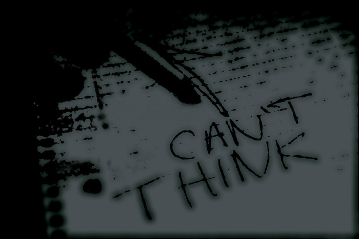 "Piece of paper with the words ""can't think"" written on it."