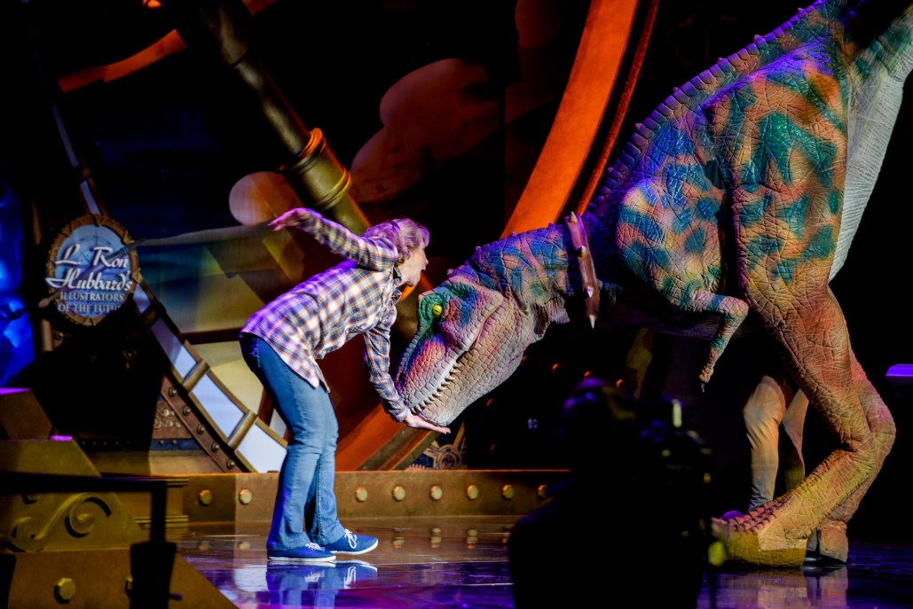 """A dinosaur and friend in a dance vignette for """"Dinosaur Dreams in Infinite Measure"""""""