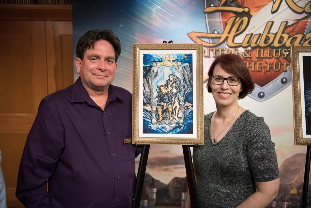 "Andrew with the illustration for his story, ""Tears for Shulna,"" and the artist, Rachel Quinlan"