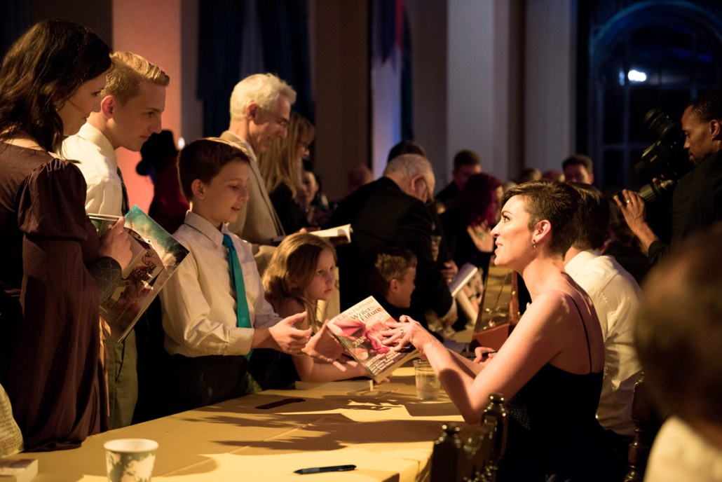 Autographing books after the awards ceremony
