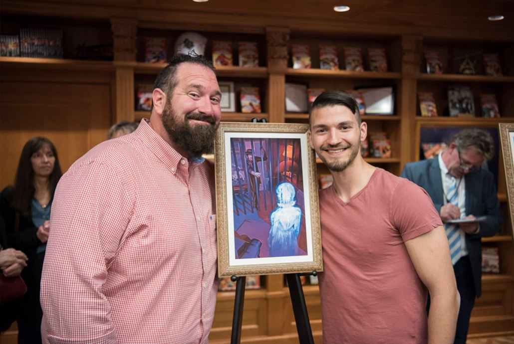 """Jake (L) with artist Ryan Richmond and the illustration for his story, """"Acquisition"""""""