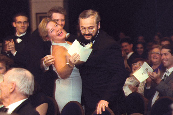 Gold Award winner Scott Nicholson gets hug from Amy Sterling Casil.
