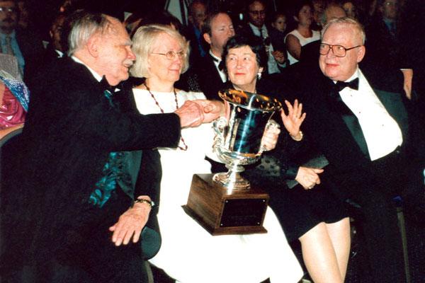 Algis Budrys congratulating Frederik Pohl.