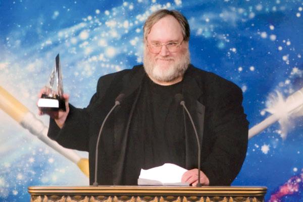 Dr. Philip Edward Kaldon on stage with his award.