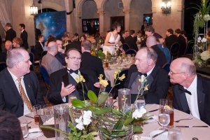 Judges Todd McCaffrey, Eric Flint and guest at the dinner.