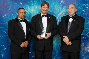 Judges Robert Castillo and Mike Resnick with Writer Winner Brennan Harvey