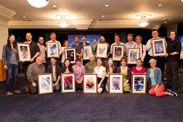 Artists present their illustrations to the writers.