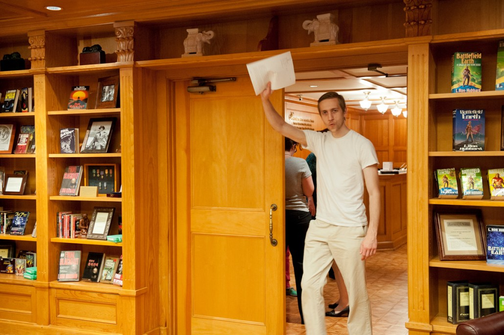 Winner Oleg Kazantsev raised his story high as he enters the library.
