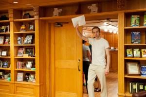 Winner Oleg Kazantsev raised his story high as he enters the library.
