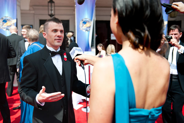 Illustrator Golden Brush Award Winner Trevor Smith being interviewed on the red carpet.