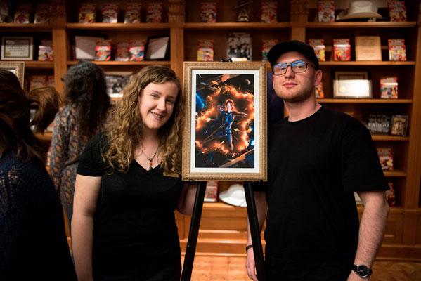 Writer winner C.L. Kagmi and Illustrator winner Michael Michera with his art for her story.