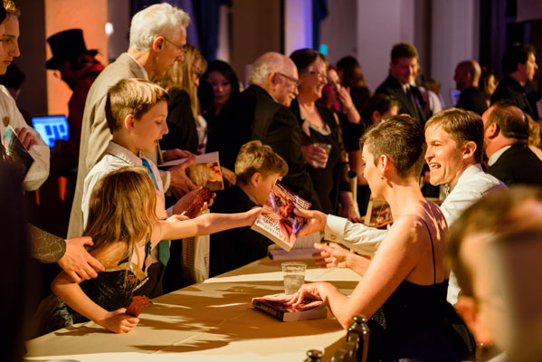 Molly Elizabeth Atkins and David VonAllmen autographing books at the reception.